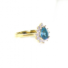 1.13 Carat Cambodian Blue Zircon And Diamond Engagement Ring In 14k Yellow Gold