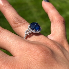 5.87 Carat Nigerian Blue Sapphire And Diamond Halo Ring In 14k White Gold