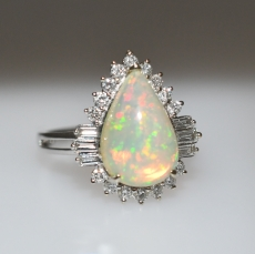 Ethiopian Opal 2.89 Carat with Round & Baguette Diamonds Halo set in 14K white Gold Ring