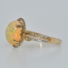 Ethiopian Opal Oval 2.49 Carat With Accented Diamond Halo Ring In 14k Yellow Gold
