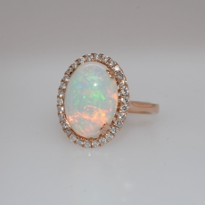 Ethiopian Opal Oval 4.01 Carat With Accented Diamond Halo Ring in 14K Rose Gold