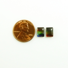 Fossilized Ammolite Emerald Cut 8x6mm Matching Pair Approximately 3.16 Carat
