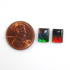 Fossilized Tri Color Ammolite Emerald Cut 9x7mm Matching Pair Approximately 3.63 Carat