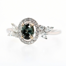 Natural Alexandrite 0.56 Carat with Diamond Halo set in 14K white Gold Ring